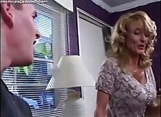 Busty mommy fucks young boy while dad is away